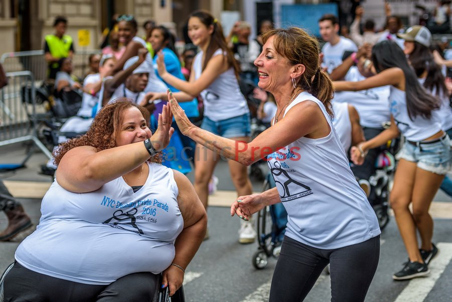 Two dancers highfiving each other at parade