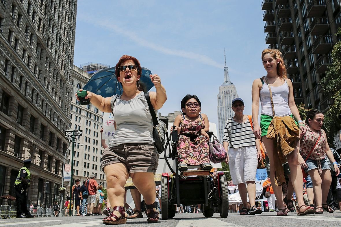 Michelle Kraus chants while she takes part in New York's first Disability Pride parade