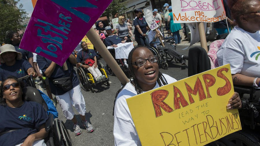 The inaugural Disability Pride Parade travels along Broadway in New York