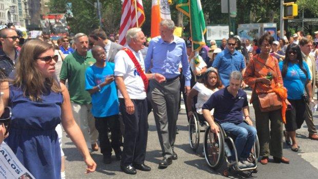 Mayor Bill de Blasio and former U.S. Sen. Tom Harkin march in the first Disability Pride Parade in Manhattan on July 12, 2015.