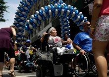 Jessica Lopez, participates in the inaugural Disability Pride Parade, Sunday, July 12, 2015, in New York.